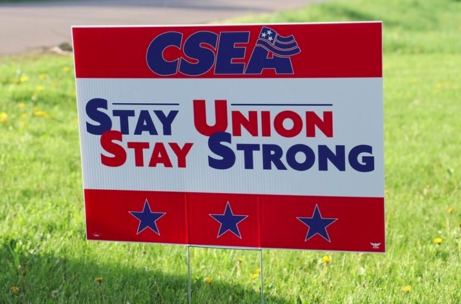 A CSEA Stay Union, Stay Strong yard sign is proudly displayed in a member's yard during a recent blitz.