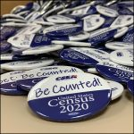 "photo of a pile of census pins which the phrase ""be counted!"" Census 2020 on them"