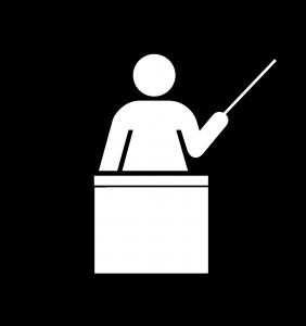 graphic of a teacher at a podium