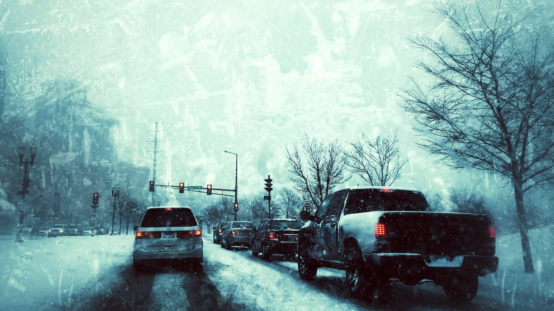 a photo of cars driving on snowy roads